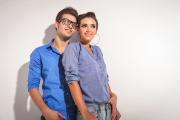Happy young fashion couple posing together