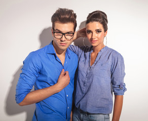 cute couple posing on grey studio background.