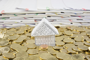 House in heap of gold coins
