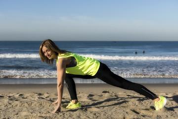 Woman streiching on the beach