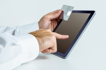 Man using tablet for online shopping
