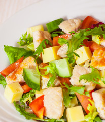 fresh vegetables salad with chicken and cheese