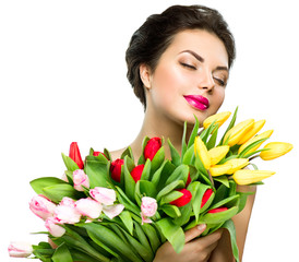 Beauty model woman with spring tulip flowers bouquet