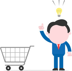 Businessman with an idea beside shopping cart