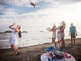Bride Throwing Bouquet For bridesmaids
