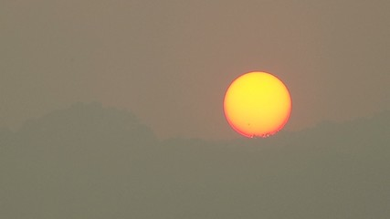 sunset behind the mountain scene when covered with heavily smog