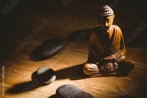 Fotobehang Standbeeld Wooden buddha statue on table