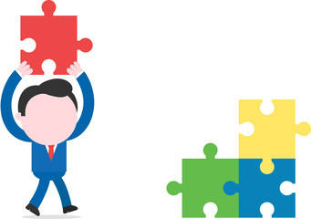 Businessman walking and lifting puzzle beside three puzzle piece