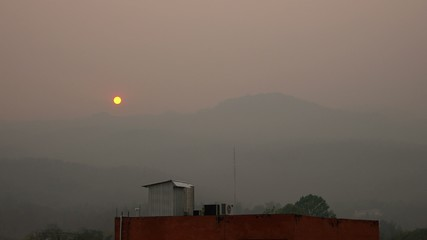 Time-lapse footage of sunset in the smoggy sky area