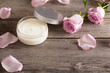 cosmetic cream with pink roses on old wooden table - 80253604