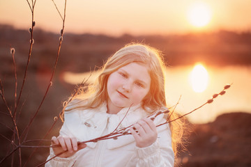 blond girl with willow on sunset