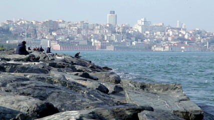People relax on the shores of the Bosphorus. Istanbul