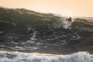 Surfer on big Ocean Wave in Bali