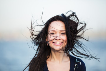 Smiling girl with long black hair