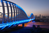 Meydan Bridge illuminated at night. Dubai, UAE - 80257802