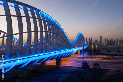 Fotobehang Brug Meydan Bridge illuminated at night. Dubai, UAE