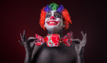 scary clown with spooky makeup and more candy