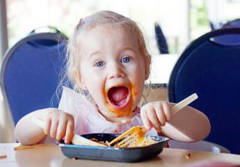 Kid having fun eating