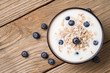 Muesli with yoghurt and ripe berries blueberry. View from the to