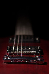 Element red electric guitar on a black background