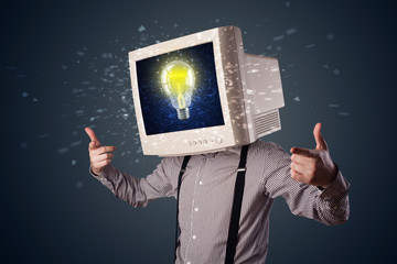 Business man with a pc monitor head and idea light bulb in the d