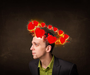 young man with heart illustrations circleing around his head