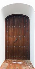 wooden  door in  arch