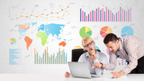 Business man and woman with colorful charts