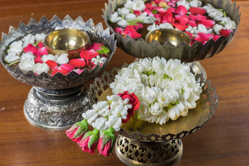 Thai garland Flowers and Water with jasmine and roses corolla in