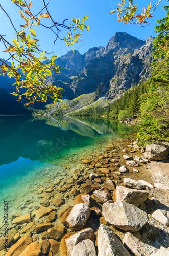 Green water mountain lake Morskie Oko, Tatra Mountains, Poland - 80260267