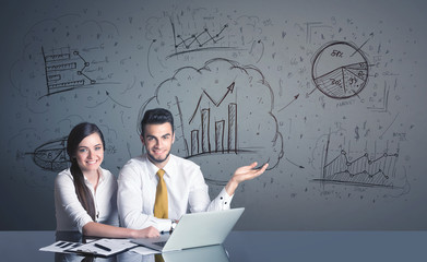 business couple with business diagrams