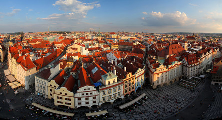 Houses with traditional red roofs in Prague Old Town Square