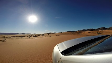 On sand dunes with a 4wd car. Morocco, Africa.