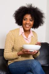 young woman having breakfast
