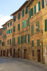 Streets of Siena, houses window shutters, Tuscany, Italy