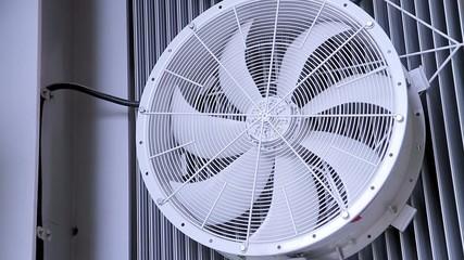 A fan rotates at power transformer at electric substation