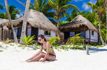 Young cute woman on tropical white sandy beach at vacation