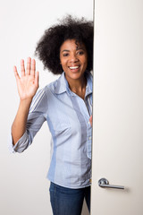 a young woman waving goodbye at the door.