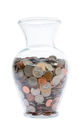 Glass vase filled with coins