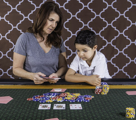 A mom teaching her son how to play poker