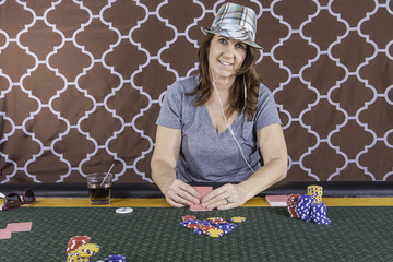 A woman playing poker at a table