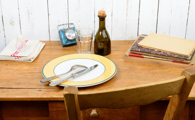 plate and cutlery on an old wooden table