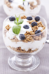 Fruity dessert with cereals on a wooden board