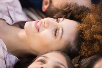 Beautiful brunette lying on blanket