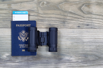 United States Passport and Binoculars on wood