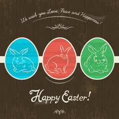 Card for Easter day with colored  eggs painted with  rabbits.