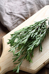 Green rosemary on the board