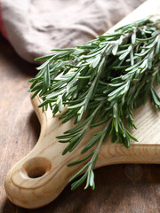 Fragrant rosemary on the board