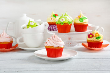 colorful cupcakes on rustic Easter table