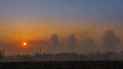 Sunrise and factory smoke time lapse